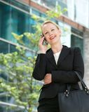 Happy businesswoman talking on cellphone outdoors Royalty Free Stock Photography