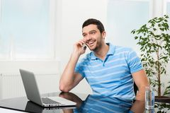Happy businesswoman talking on mobile phone Royalty Free Stock Photography