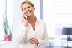Happy businesswoman talking on mobile phone Stock Image