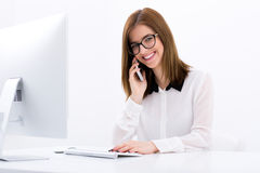 Happy businesswoman talking on the phone Royalty Free Stock Images