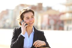 Happy businesswoman talking on phone in a park stock photography