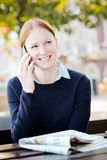 Happy Businesswoman Talking by Phone Royalty Free Stock Images