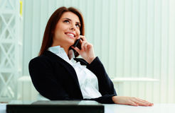 Happy businesswoman talking on the phone Royalty Free Stock Photo