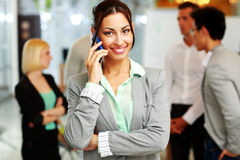 Happy businesswoman talking on the smartphone Stock Photos