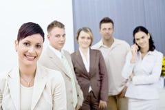 Happy businesswoman and team Stock Photo