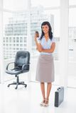 Happy businesswoman texting on her mobile phone Stock Images