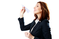 Happy businesswoman throwing paper plane Royalty Free Stock Photos