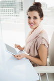 Happy businesswoman touching tablet pc Stock Images