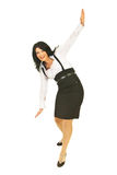 Happy businesswoman trying to keep balance. Happy business woman trying to keep her balance isolated on white background Royalty Free Stock Images