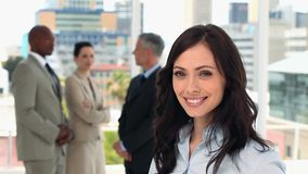 Happy businesswoman turning her head stock footage