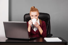 Happy businesswoman typing on laptop at her desk Royalty Free Stock Photography