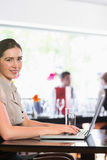 Happy businesswoman typing on laptop Stock Photos