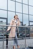 happy businesswoman with umbrella talking on smartphone stock photos