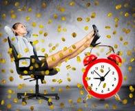 Happy businesswoman under coin rain Stock Photo