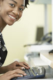 Happy Businesswoman Using Computer In Office Stock Photo