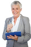 Happy businesswoman using her clipboard Stock Photos