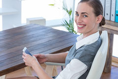 Happy businesswoman using her smartphone Royalty Free Stock Images