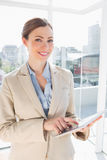 Happy businesswoman using her tablet pc Stock Photos