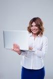 Happy businesswoman using laptop Stock Photography