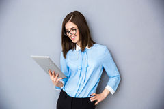 Happy businesswoman using tablet computer Stock Photos