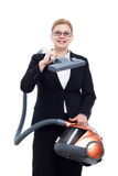Happy businesswoman with vacuum cleaner Stock Image