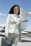 Happy Businesswoman Walking On Airfield Stock Photography
