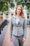 Happy Businesswoman Walks in a City Royalty Free Stock Photos