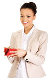 Happy businesswoman with wallet. Stock Image