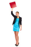 Happy businesswoman waving ring binder. Stock Photos