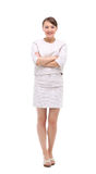 Happy businesswoman wearing beige suit standing and folding arms Royalty Free Stock Images
