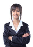 Happy businesswoman wearing black suit standing and folding arms Stock Image