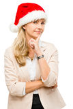 Happy businesswoman wearing santa hat thinking of christmas isol Stock Image