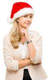 Happy businesswoman wearing santa hat thinking of christmas isol Stock Image
