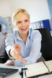 Happy businesswoman welcoming client Stock Images