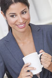 Happy Businesswoman Woman Drinking Tea or Coffee Royalty Free Stock Photos