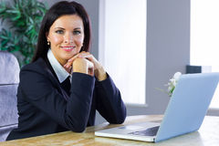 Happy businesswoman working at her desk Royalty Free Stock Photo