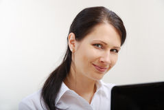 Happy businesswoman working with a laptop. Royalty Free Stock Photo