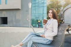 Caucasian businesswoman working with laptop outdoors Royalty Free Stock Images