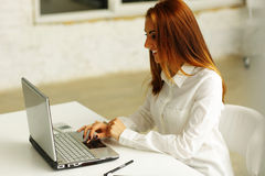 Happy businesswoman working on laptop Stock Image