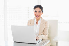 Happy businesswoman working on a laptop Royalty Free Stock Photo