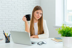 Happy businesswoman working on the laptop Stock Photos