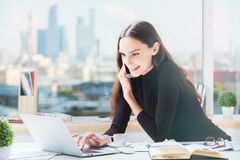 Happy businesswoman working in office Royalty Free Stock Photography