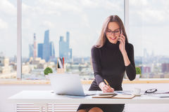 Happy businesswoman at workplace Stock Photography