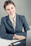 Happy businesswoman in the workplace Royalty Free Stock Photo