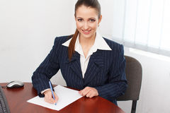 Happy businesswoman write on blank paper with pen Stock Images