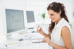 Happy businesswoman writing on notepad Stock Photography