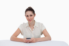 Happy businesswoman writing a text message Stock Image