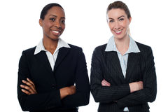 Happy businesswomen with arms crossed Royalty Free Stock Photography