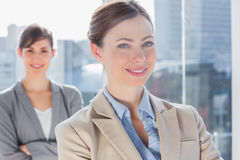 Happy businesswomen with arms crossed Stock Photography