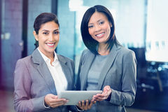 Happy businesswomen with digital tablet royalty free stock images